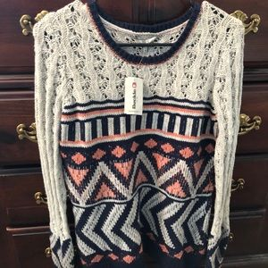 Sweater with tags
